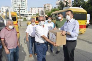 Yenişehir'de yardımlar sürüyor